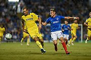 AFC Wimbledon Forward, James Hanson (18) and Portsmouth Defender, Brandon Haunstrup (38) during the Carabao Cup match between Portsmouth and AFC Wimbledon at Fratton Park, Portsmouth, England on 14 August 2018.