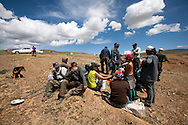 Miners having a pause from work at Ulan Bulac mining site. Project about illegal gold mining in Mongolia where people from different backgrounds spend their summer and late summer trying to find minerals to get extra money for their lives.