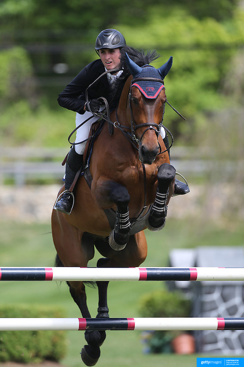 Michael Hughes riding Macarthur in action during the $35,000 Grand Prix of North Salem presented by Karina Brez Jewelry during the Old Salem Farm Spring Horse Show, North Salem, New York, USA. 15th May 2015. Photo Tim Clayton