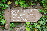 Coastal path signpost to Bossington Beach, Porlock and Porlock Weir in Exmoor, Somerset, UK