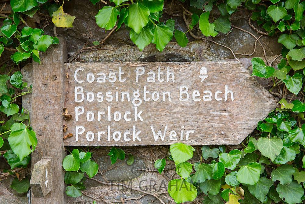 Coastal path signpost to Bossington Beach, Porlock and Porlock Weir in Exmoor, Somerset, UK