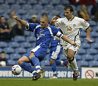 Photo: Aidan Ellis.<br /> Leeds United v Cardiff City. Coca Cola Championship. 19/08/2006.<br /> Cardiff's Darren Purse holds off Leeds Robbie Blake