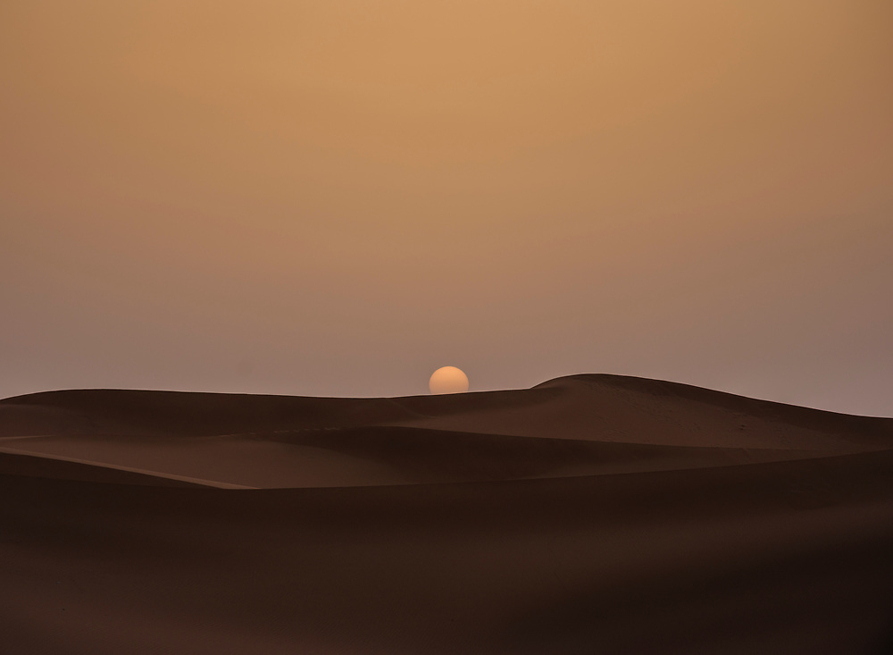 MEKNES - TAFILALET, MOROCCO - CIRCA APRIL 2017: Sunrise over the dunes of the Sahara Desert