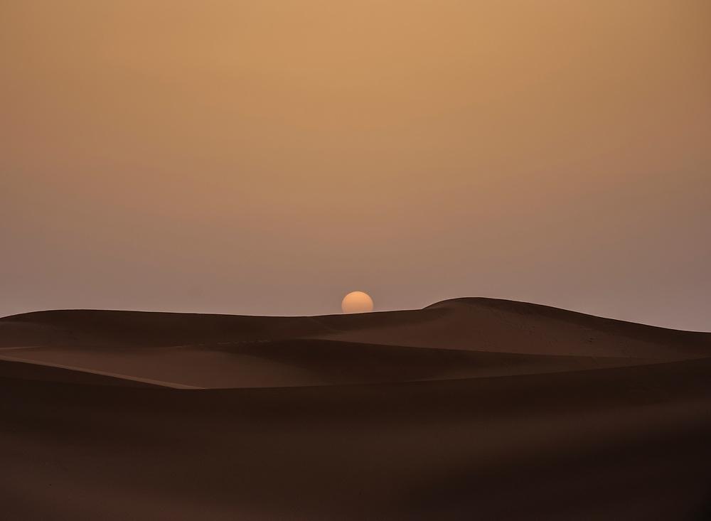 MEKNES - TAFILALET, MOROCCO - CIRCA APRIL 2017: Sunrise over the dunes of the Sahara Desert