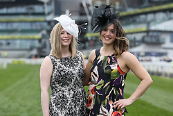 © Licensed to London News Pictures. 08/04/2016. Liverpool, UK. Two women pose in their hats on Ladies Day at the Grand National 2016 at Aintree Racecourse near Liverpool. The race, which was first run in 1839, is the most valuable jump race in Europe. Photo credit : Ian Hinchliffe/LNP