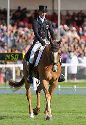 Andrew Nicholson and NEREO lie in sixth place as they chase the coveted Rolex Grand Slam and $350,000 - The Dressage phase of the Mitsubishi Motors Badminton Horse Trials, Saturday May 4th 2013. Photo by:  Nico Morgan / i-Images