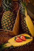 Pineapples cut open in basket