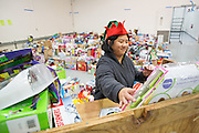 Mory Ware of Cisco Systems, Inc., Global Procurement Services department sorts donated toys at The Family Giving Tree in Milpitas, California, on December 18, 2014. (Stan Olszewski/SOSKIphoto)