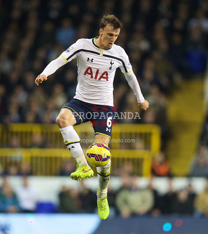 LONDON, ENGLAND - Sunday, November 30, 2014: Tottenham Hotspur's Vlad Chiriches in action against Everton during the Premier League match at White Hart Lane. (Pic by David Rawcliffe/Propaganda)