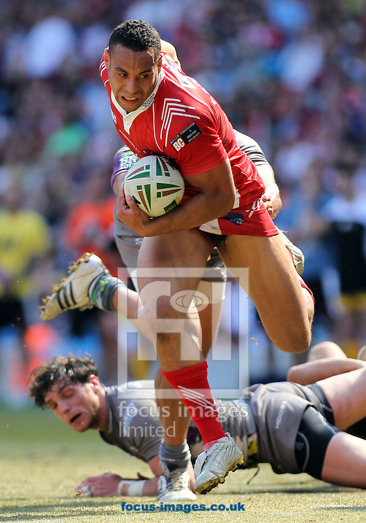 Picture by MIchael Sedgwick/Focus Images Ltd. 07900 363072.27/05/12.Jody Broughton of Salford City Reds breaks through the tackle of Leroy Cudjoe of Huddersfield Giants during the Stobart Super League 'Magic Weekend' match at the Etihad Stadium, Manchester.