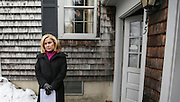 An uninterested resident looks out of the window as Heidi Cruz, wife of Republican presidential candidate Sen. Ted Cruz, R-Texas, goes door to door campaigning for her husband in Nashua, N.H. Friday, Jan. 8, 2016.  CREDIT: Cheryl Senter for The New York Times