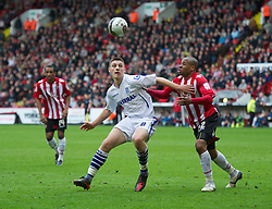SHEFFIELD, ENGLAND - Saturday, March 17, 2012: Tranmere Rovers' Jake Cassidy, making his debut for the club after joining on-loan from Wolverhampton Wanderers, in action against Sheffield United's Matthew Hill during the Football League One match at Bramall Lane. (Pic by David Rawcliffe/Propaganda)