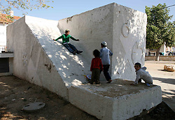 Sderot  - May 2nd ,  2008 - Children play on a bomb shelter in Sderot, Southern Israel, The small town has frequent rocket attacks from Gaza, May 2nd, 2008. Picture by Andrew Parsons / i-Images