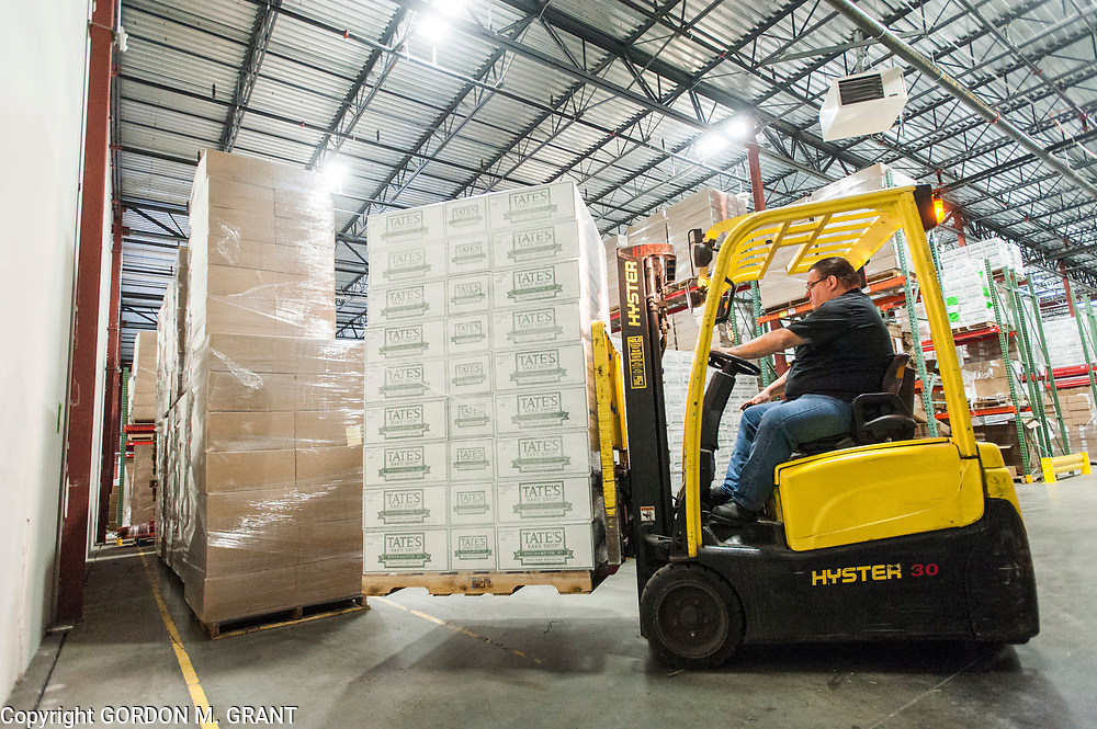 A pallet of cookies is unloaded at the Tate's Bake Shop distribution center at the Hampton Business District at Gabreski Airport in Westhampton, Jan. 16, 2018. Tate's Bake Shop is expanding it's distribution facility into a newly constructed building at the site.