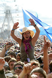 Fans of Kings of Leon on the main stage, T in the Park, Sunday 8 July 2007..T in the Park festival took place on the 6th, 7th and 8 July 2007, at Balado, near Kinross in Perth and Kinross, Scotland. This was the first time the festival had been held over three days..Pic ©Michael Schofield. All Rights Reserved..