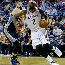 Mar 21, 2017; New Orleans, LA, USA; New Orleans Pelicans forward DeMarcus Cousins (0) drives past Memphis Grizzlies center Marc Gasol (33) during the second half of a game at the Smoothie King Center. The Pelicans defeated the Grizzlies 95-82. Mandatory Credit: Derick E. Hingle-USA TODAY Sports