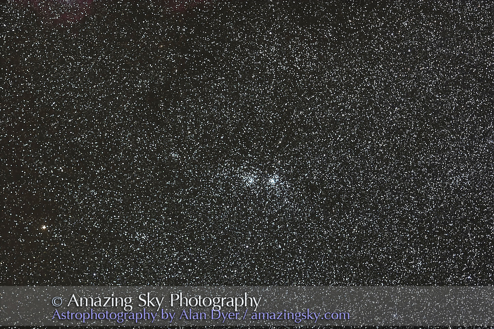 Double Cluster, with 135mm Canon L-lens at f/2.8 and Canon 20Da camera at ISO 800 for stack of 4 x 3 minute exposures. Taken Sept. 8, 2007. Simulates binocular field. Slightly soft focus.