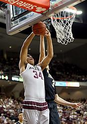 Vanderbilt's Luke Kornet (3) blocks a shot attempt by Texas A&M's Tyler Davis (34) during the first half of an NCAA college basketball game, Saturday, March 5, 2016, in College Station, Texas. (AP Photo/Sam Craft)