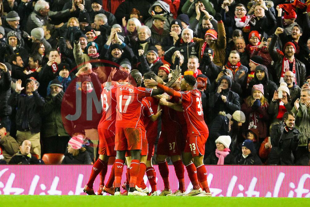 Liverpool's Mario Balotelli celebrates after scoring the winning goal 3-2 - Photo mandatory by-line: Matt McNulty/JMP - Mobile: 07966 386802 - 10/02/2015 - SPORT - Football - Liverpool - Anfield - Liverpool v Tottenham Hotspur - Barclays Premier League