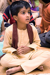 Child watching the celebrations for Navratri; the Hindu festival of Nine Nights,