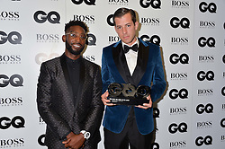 Left to right, TINIE TEMPAH and MARK RONSON at the GQ Men of The Year Awards 2016 in association with Hugo Boss held at Tate Modern, London on 6th September 2016.