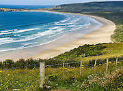 The South Pacific Ocean makes waves onto a beach at Florence Hill Lookout, in the Catlins District, South Island, New Zealand.