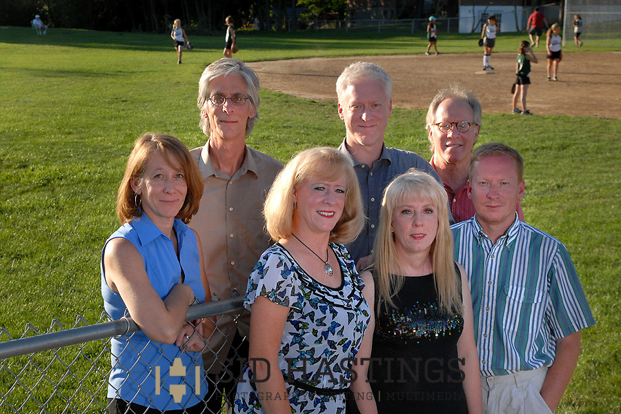 28 JUNE 2011 -- GREEN PARK, Mo. -- Kay Held (left), Chris Krebeck, Claire Becher, Craig Krebeck, Carol Purvis, Keith Krebeck and Kent Krebeck pose for a photograph on Krebeck Field, named in honor of their father Charles J. Krebeck, as a girls' softball game unfolds at St. Simon the Apostle Church in Green Park, Mo. The family recently established the Krebeck Foundation to fund CYC youth sports for children unable to afford the costs of participation. Photo &copy; copyright 2011 Sid Hastings.<br />