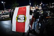 Frankfurt | 07 October 2016<br /> <br /> Am Freitag (07.10.2016) versammelten sich in Wetzlar etwa 80 Neonazis aus dem Umfeld der NPD, von neonazistischen Freien Kameradschaften, dem sog. Freien Netz Hessen und der Identit&auml;ren Bewegung zu einer Demonstration &quot;gegen &Uuml;berfremdung&quot;. Die geplante Demo-Route war von etwa 1600 Anti-Nazi-Aktivisten blockiert, daher wurde den Neonazis eine neue Demoroute durch Altstadt und Innenstadt von Wetzlar vorbei am Wetzlarer Dom zugewiesen. Auch hier stellten sich den Rechten immer wieder Aktivisten in den Weg.<br /> Hier: Neonazis vor der Demo mit einer Fahne der NPD.<br /> <br /> photo &copy; peter-juelich.com<br /> <br /> FOTO HONORARPFLICHTIG, Sonderhonorar, bitte anfragen!