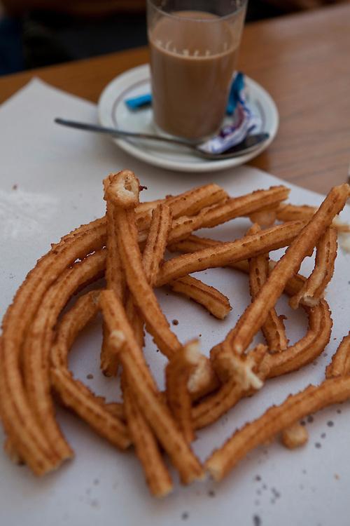 """Traditional """"café con churros"""" in Cadiz, Andalucía, Spain."""