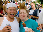 Everybody wanted to have their picture taken with the newly stylized buzz cut. Grand Old Day Street Fair St Paul Minnesota USA