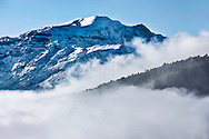 High Atlas Mountains with snow and morning fog.