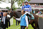 PIVOINE (4) ridden by Rob Hornby and trained by Andrew Balding enter the Winners Enclosure after  winning The John Smiths Diamond Jubilee Cup over 1m 2f (£200,000)  during the John Smiths Diamond Cup Meeting at York Racecourse, York, United Kingdom on 13 July 2019.