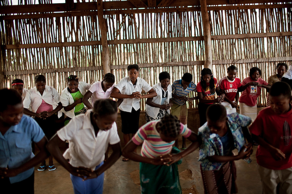 "Children from Mulungo rural primary school, practice a dance singing a song that says ""Beware, AIDS can kill"" before a presentation to other schoolmates, during an HIV prevention campaign organized by CARE,  part of a national education program. Mulungo, west of Vilanculos, Mozambique, Aug. 2009.  Knowledge about HIV and HIV prevention greatly improved in the last years among youth, however, knowledge about means of transmission is still low."