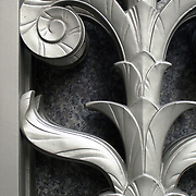 Close-up of Architecture Art Deco detail of gate with plant/flower design.