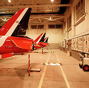 BAE Systems Hawk tails belonging to the elite 'Red Arrows', Britain's prestigious Royal Air Force aerobatic team, forms part of the team's highly-skilled group of support ground crew who outnumber the pilots 8:1. The team's aircraft are in some cases 25 years old and their airframes require constant attention, with frequent overhauls needed. In these shelters were housed the Lancaster bombers 617 Dambusters squadron who attacked the damns of the German Ruhr valley on 16th May 1943 using the Bouncing Bomb. The Red Arrows nearby offices as their administrative nerve-centre for the 90-plus displays they perform a year. .