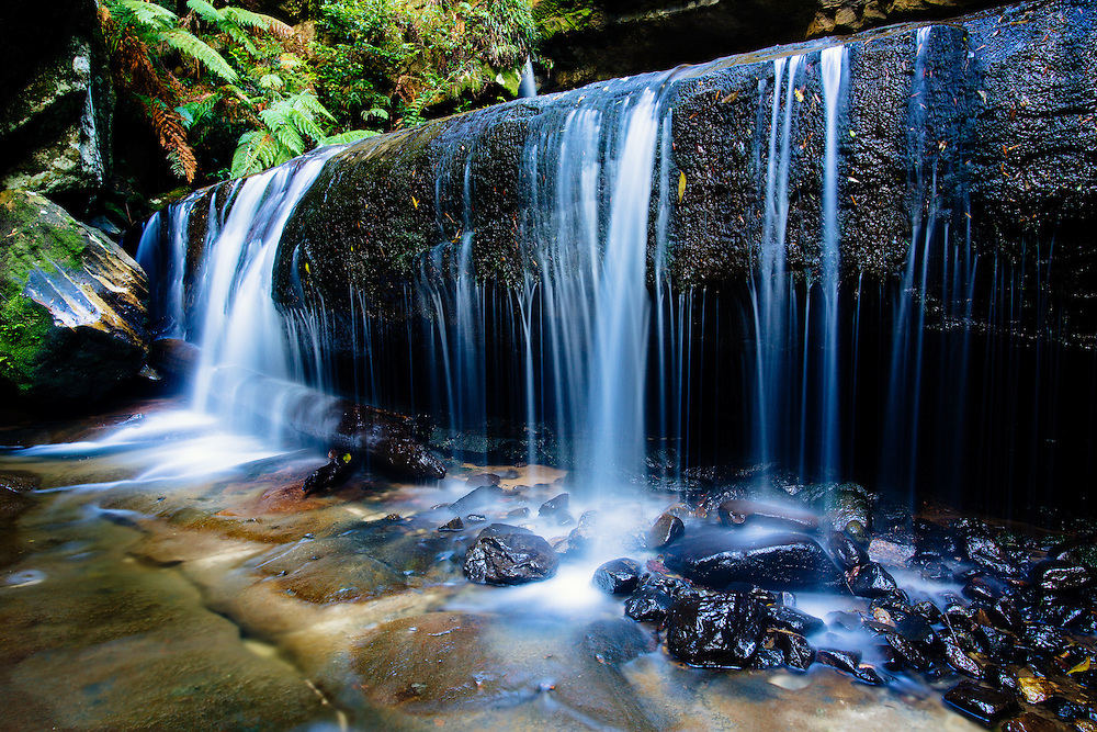 A shaded waterfall below Govetts Leap in Blue Mountains National Park.