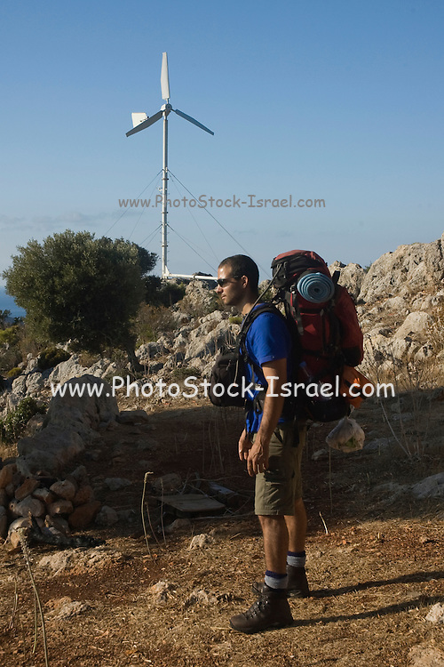 Turkey, Antalya Province, Olympos National Park, Cape Gelidonya A male backpacker with his equipment. Model Release Available