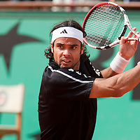 5 June 2009: Fernando Gonzalez of Chile eyes the ball as he prepares a backhand during the Men's Singles Semi Final match on day thirteen of the French Open at Roland Garros in Paris, France.