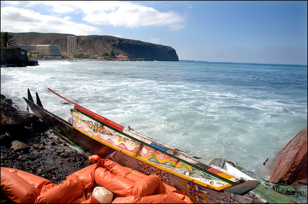 "Tenerife / Los Cristianos June 7, 2006 - A fishing boat called ""Cayucos"" by the inhabitants of the island of Tenerife, is found on the beach after one night of storm. Spanish authorities say the Canary Islands has intercepted more than 7,000 imigrants since January"