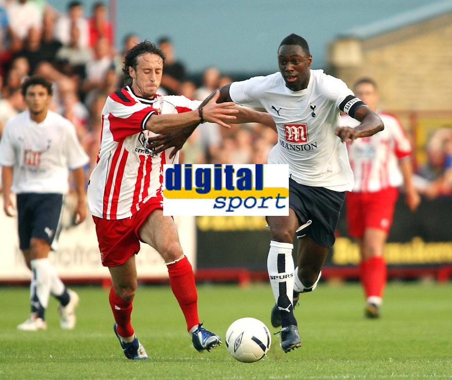 Photo: Chris Ratcliffe.<br /> Stevenage Borough v Tottenham Hotspur. Pre Season Friendly. 25/07/2006.<br /> Ledley King of Spurs tussles with Adam Miller of Stevenage.