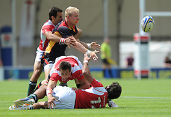 Sebastian Fromm of Germany passes the ball under pressure  - Photo mandatory by-line: Dougie Allward/JMP - Mobile: 07966 386802 - 11/07/2015 - SPORT - Rugby - Exeter - Sandy Park - European Grand Prix 7s