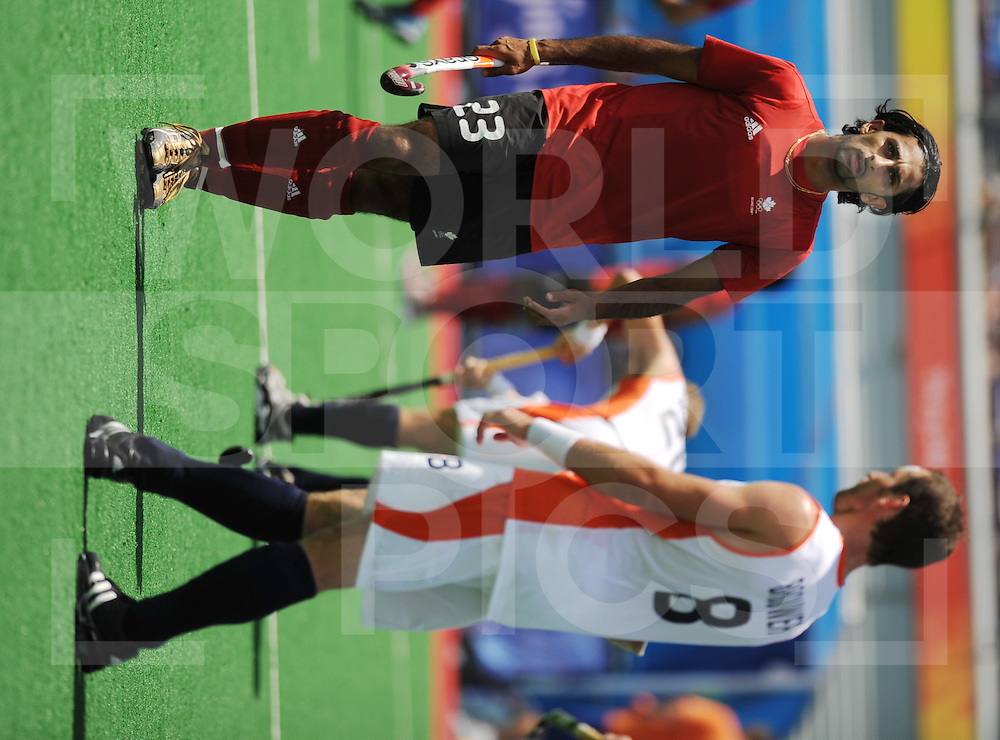 080814 Beijling Chi..Olympic games hockey men Netherlands - Canada..Ronald Brouwer and from canada Bindi Kullar...FFU Press Agency©2008 Frank Uijlenbroek