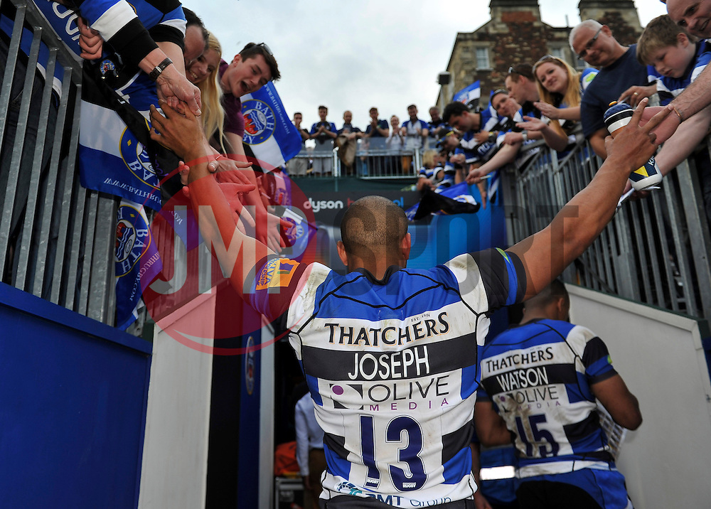 Jonathan Joseph of Bath Rugby leaves the field having just played his final home match for Bath Rugby - Photo mandatory by-line: Patrick Khachfe/JMP - Mobile: 07966 386802 23/05/2015 - SPORT - RUGBY UNION - Bath - The Recreation Ground - Bath Rugby v Leicester Tigers - Aviva Premiership Semi-Final