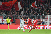 Liverpool forward Mohamed Salah (11) battles for possession with Bayern Munich defender David Alaba (27) during the Champions League match between Bayern Munich and Liverpool at the Allianz Arena, Munich, Germany, on 13 March 2019.