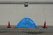 The tents of homeless people along the banks of the Sumida River near Asakusa, Tokyo, Japan. Monday, June 21st 2010
