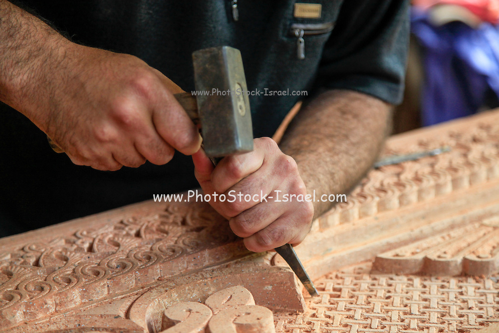 Artisan carves wood for a church. Photographed in Armenia