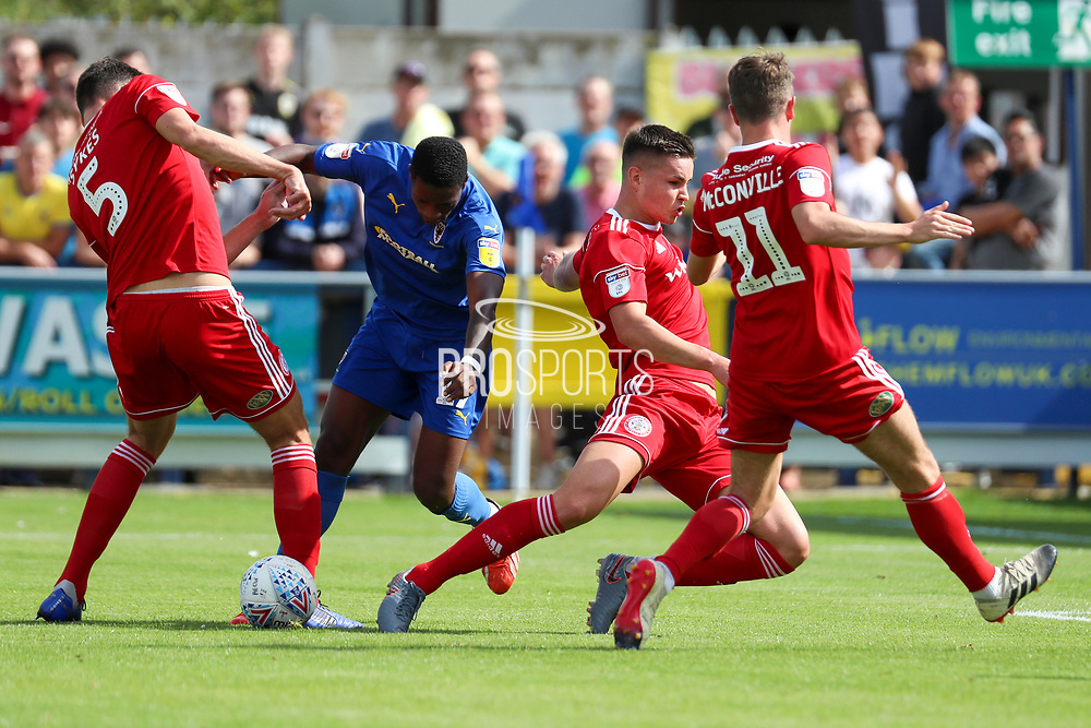 AFC Wimbledon attacker Michael Folivi (17) battles for possession with Accrington Stanley defender Ross Sykes (5) during the EFL Sky Bet League 1 match between AFC Wimbledon and Accrington Stanley at the Cherry Red Records Stadium, Kingston, England on 17 August 2019.