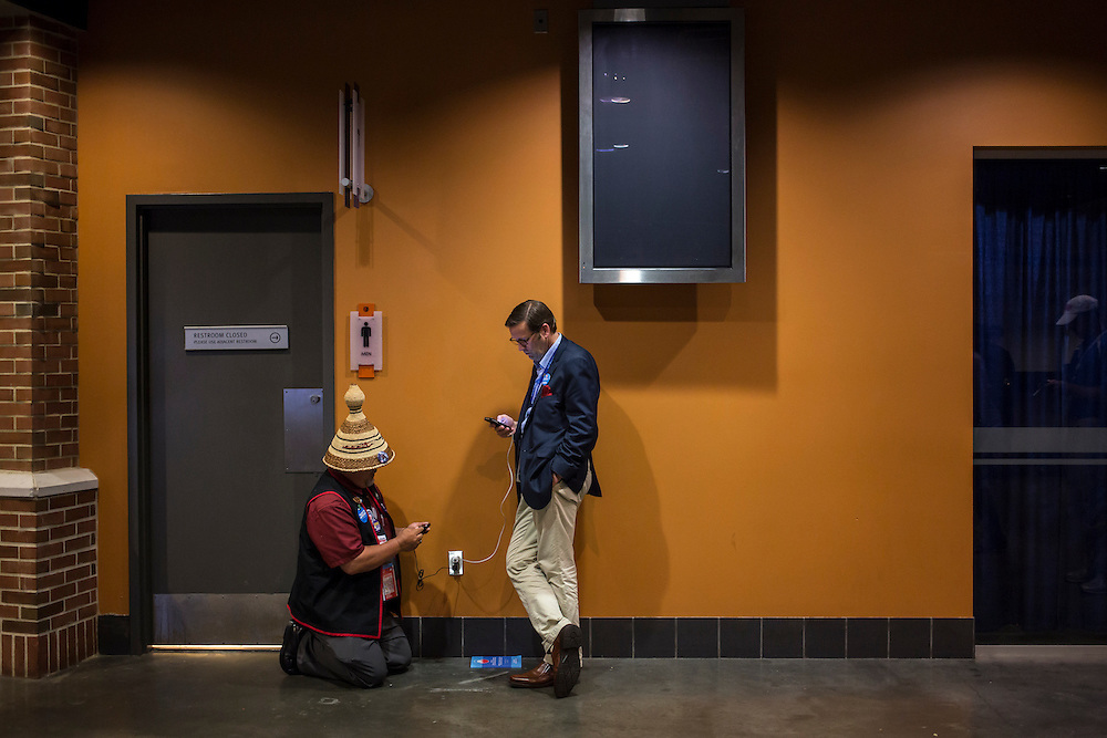 People charge their cell phones in the hallway at the Democratic National Convention on Tuesday, September 4, 2012 in Charlotte, NC.