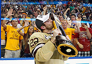 Boston College's Paul Carey celebrates with the National Championship trophy after the NCAA Frozen Four college hockey tournament final game against Ferris State Saturday, April 7, 2012, in Tampa, Fla. Boston College won 4-1 to claim the National Championship. (AP Photo/Mike Carlson)