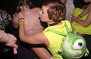 A girl wearing a Monsters inc. backpack in a club, Passion, Emporium, Milton Keynes, UK, 2002